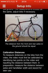 Установка велосипеда на велостанок для настройки. Фото